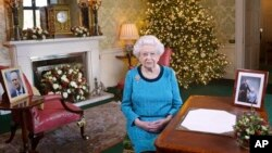 Britain's Queen Elizabeth II poses for a photo in Buckingham Palace in London. The royal family is releasing documents from the reign of King George III in an attempt to rehabilitate his legacy.