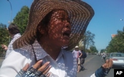 An identified woman, Boeung Kak lake protester, crying at the demonstration Monday.