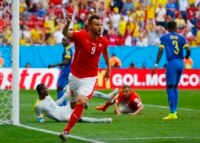 Switzerland's Haris Seferovic celebrates after scoring a goal to defeat Ecuador in their 2014 World Cup Group E soccer match at the Brasilia national stadium in Brasilia, June 15, 2014. REUTERS/Paul Hanna