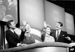FILE - President Ronald Reagan, far right, first lady Nancy Reagan, right, Vice President George Bush and his wife, Barbara, react to cheers from the floor at the final session of the Republican National Convention in Dallas, Texas, Aug. 23, 1984.