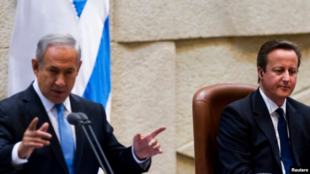British Prime Minister David Cameron (R) listens as Israel's Prime Minister Benjamin Netanyahu delivers a speech at the Knesset, Israel's parliament, in Jerusalem, March 12, 2014.
