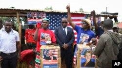 FILE - Comedians stage a mock election in the village of Kogelo, the home town of Sarah Obama, step-grandmother of President Barack Obama, in western Kenya, Tuesday, Nov. 8, 2016.