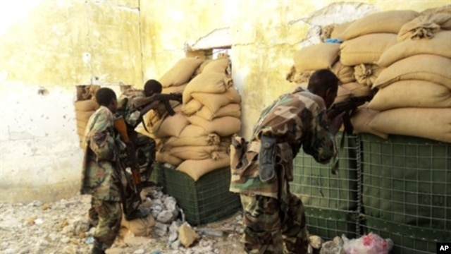 Somali government soldiers man a position in Mogadishu on April 30, 2011