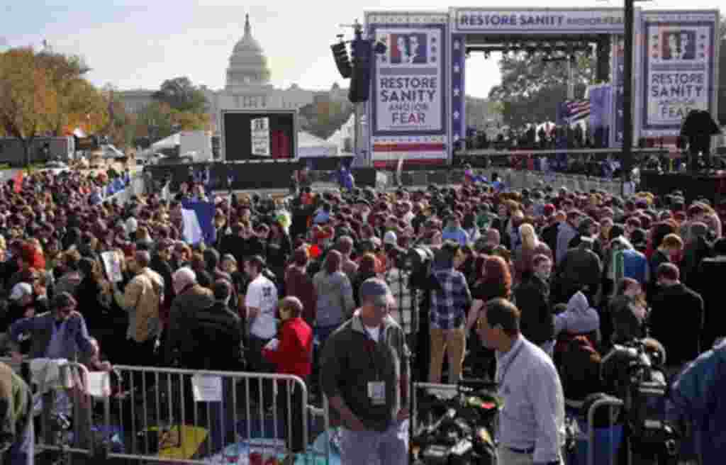 People gather near the stage for the Rally to Restore Sanity and/or Fear event on the National Mall in Washington, 30 Oct 2010