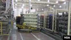 Roboti u kompaniji National Spinning u Burlingtonu, u Severnoj Karolini