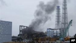 Smoke rising from Unit 3 of the tsunami-stricken Fukushima Dai-ichi nuclear power plant, Okumamachi, Japan, March 21, 2011.