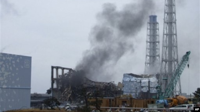 Smoke rising from Unit 3 of the tsunami-stricken Fukushima Dai-ichi nuclear power plant, Okumamachi, Japan, March 21, 2011.