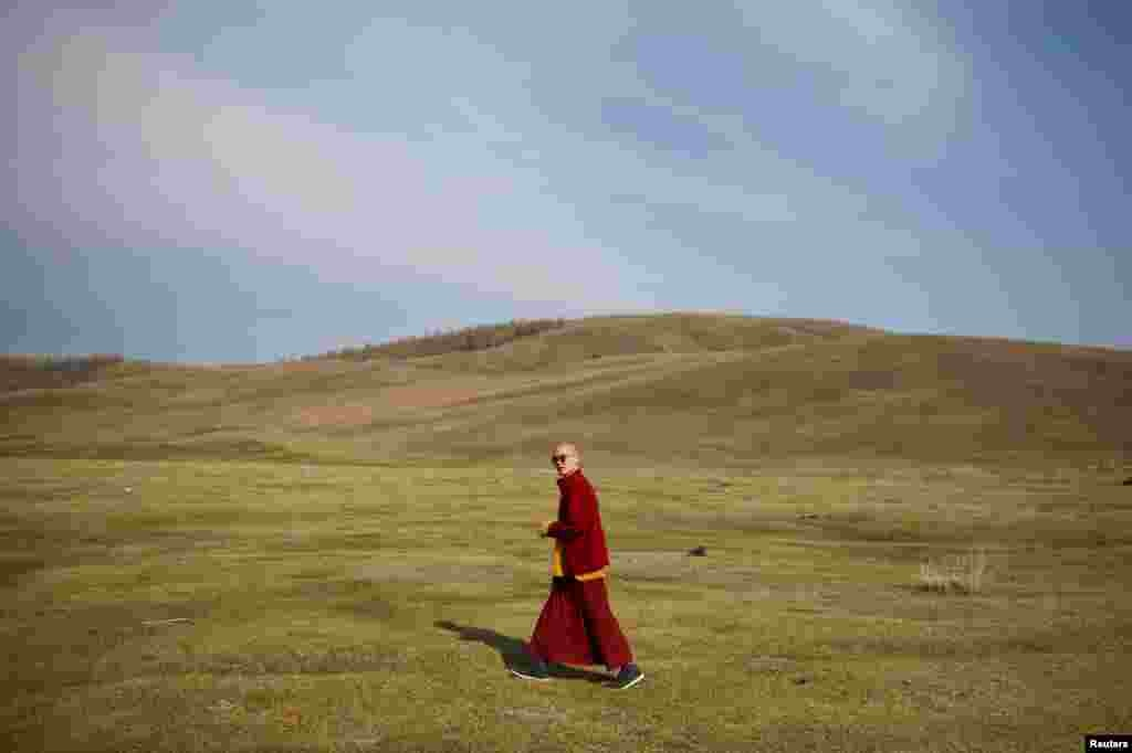 Senior Buddhist monk Lobsang Tayang walks outside the Amarbayasgalant Monastery in the Baruunburen district, Selenge province, Mongolia.