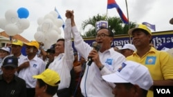 Kem Sokha, left, and Sam Rainsy at a campaign rally in Kampong Cham province.