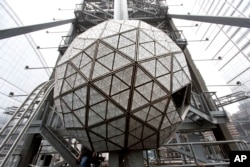 FILE - The Waterford crystal ball is shown atop One Times Square on Dec. 27, 2015, in New York.