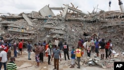 FILE - In this photo taken Sept. 13, 2014, rescue workers search for survivors in the rubble of a collapsed building belonging to the Synagogue Church of All Nations in Lagos, Nigeria.