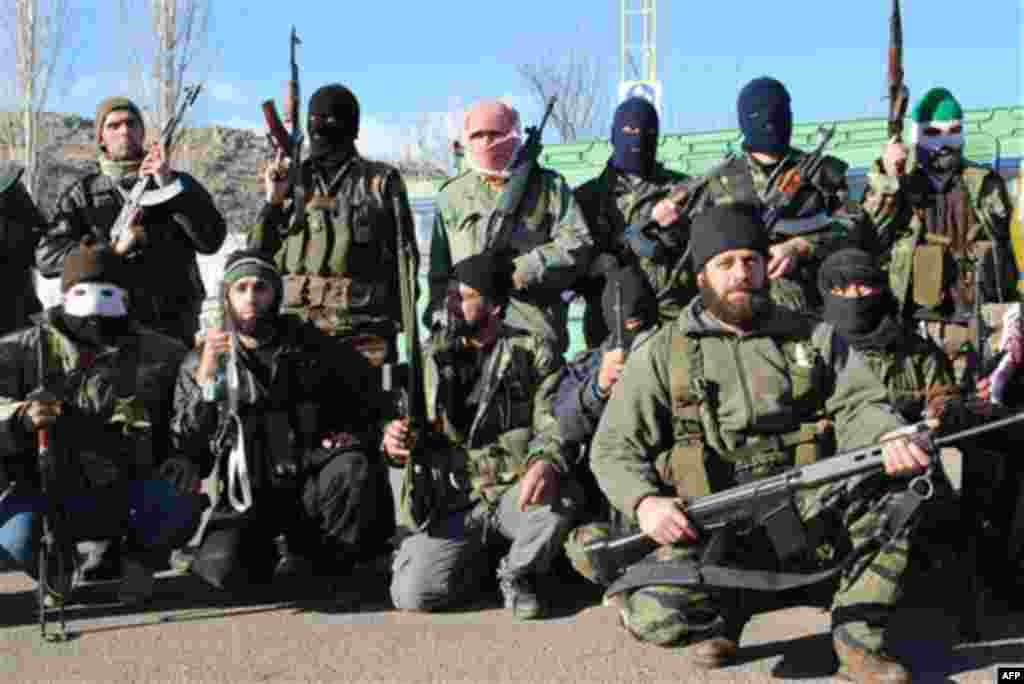 Syrian army defectors gather at the mountain resort town of Zabadani, Syria, near the Lebanese border, on Friday Jan. 20, 2012. President Bashar Assad's forces attacked Zabadani, some 17 miles (27 kilometers) west of the capital, for six days, sparking fi