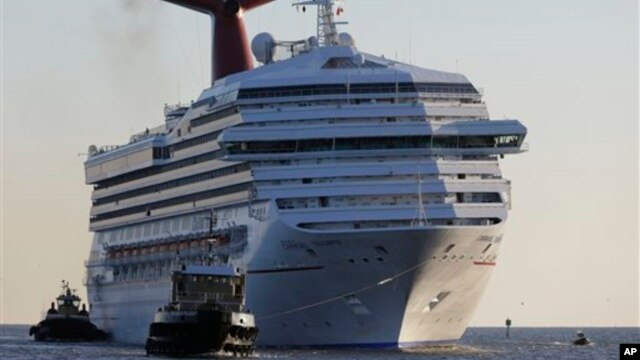 Carnival Triumph is towed into Mobile Bay Feb. 14, 2013