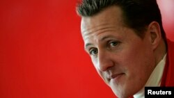 Michael Schumacher of Germany looks on during a news conference at the end of the official presentation of the new Ferrari Formula One race car 248 F1 at the Mugello racetrack in Scarperia, central Italy, January 24, 2006. REUTERS/Tony Gentile - RTR188ZY