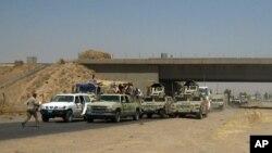 Lực lượng an ninh Iraq đi đến Baghdad một ngày sau khi máy phiến quân Hồi giáo nắm quyền kiểm soát một phần lớn TP Mosul, Iraq, ngày 11/6/2014.