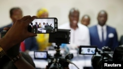 Journalists use their mobile phones and cameras at a candidate's pre-election news conference in Kinshasa, Democratic Republic of Congo, Dec. 25, 2018.