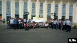 In this undated image published by Iranian news agency ILNA on July 30, 2018, railway workers stage a protest in the northwestern Iranian city of Tabriz to demand resolution of labor complaints including unpaid salaries.