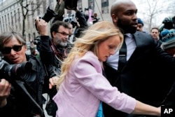 FILE -Stormy Daniels arrives at federal court in New York to attend a court hearing where a federal judge is considering how to review materials that the FBI seized from President Donald Trump's personal lawyer.