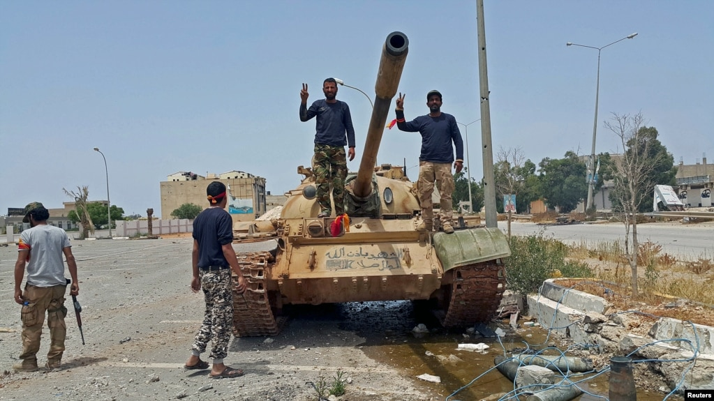 Islamic state suffering setbacks in libya file members of libyan pro government forces on a tank in benghazi may sciox Choice Image
