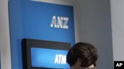 Customers are seen in front of ANZ Bank, Australian and New Zealand Banking Group Ltd., ATM machine. The four largest banks—Acleda, Canadia, ANZ Royal and Cambodia Public—account for 70 percent of deposits and loans.