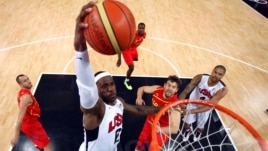 United States'  LeBron James (6) dunks against Spain during the men's gold medal basketball game at the 2012 Summer Olympics  in London on Sunday, Aug. 12, 2012.