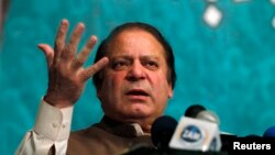 Nawaz Sharif speaks to party members during a function in Lahore in this May 20, 2013 file photo.