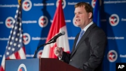 Canadian Foreign Affairs Minister John Baird speaks at a U.S. Chamber of Commerce luncheon in Washington, Jan. 16, 2014.