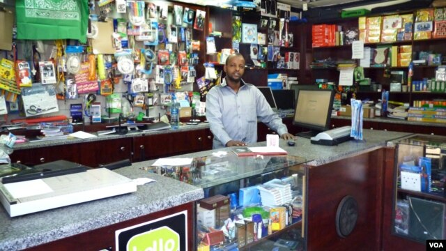 Abdikadir Hassan Mohammed has been a victim of several robberies in his Mayfair shop in Johannesburg. (VOA/S. Honorine)