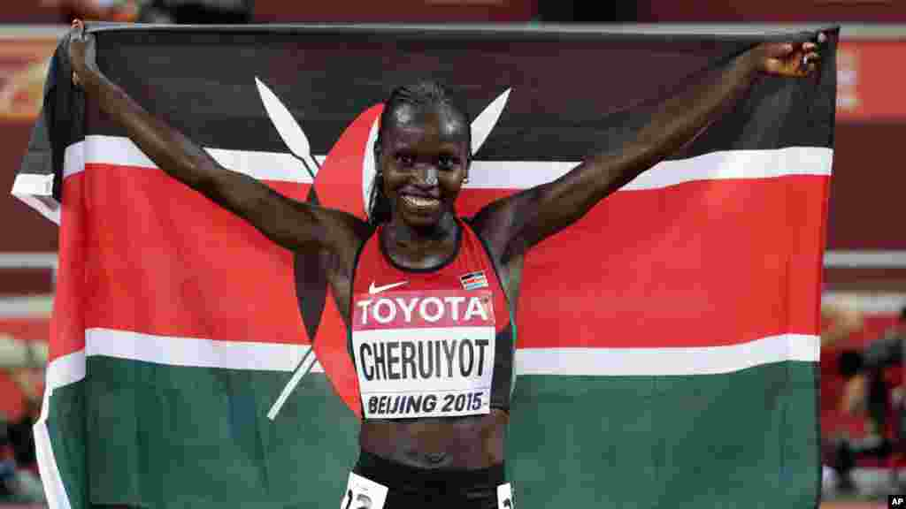 Kenya's Vivian Jepkemoi Cheruiyot celebrates after winning the gold medal in the women's 10,000m final at the World Athletics Championships at the Bird's Nest stadium in Beijing, Monday, Aug. 24, 2015