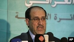Iraqi Prime Minister Nouri al-Mailiki (Aug. 2011 file photo).