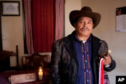 Tomas Saloj Guit, indigenous mayor of Solola, poses for photos at his office in Solola, Guatemala, Jan. 16, 2017.