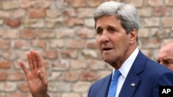 U.S. Secretary of State John Kerry leaves the hotel where closed-door nuclear talks on Iran took place in Vienna, Austria, July 14, 2014.