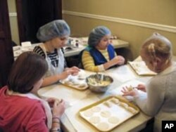 Even the youngest members of the kids' table can shape circles of homemade dough into traditional potato pierogies.