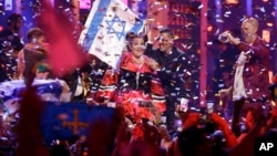 In this May 12, 2018 file photo, Netta Barzilai from Israel celebrates after winning the Eurovision 2018 song contest in Lisbon, Portugal. (AP Photo/Armando Franca, File)