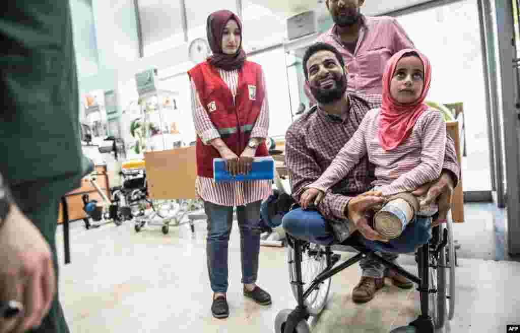Eight-year-old Syrian refugee Maya Merhi and her father arrive at an Istanbul clinic to get prosthetic legs for the child, who was born without legs. Earlier this month, Maya was captured in photos at a Syrian refugee camp. She was walking on artificial limbs made of plastic tubing and tin cans. But after the pictures were seen around the world, she was brought to Istanbul for treatment.