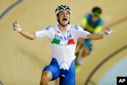 Elia Viviani of Italy celebrates after winning gold in the men's omnium cycling event at the Rio Olympic Velodrome during the 2016 Summer Olympics in Rio de Janeiro, Brazil, Aug. 15, 2016.