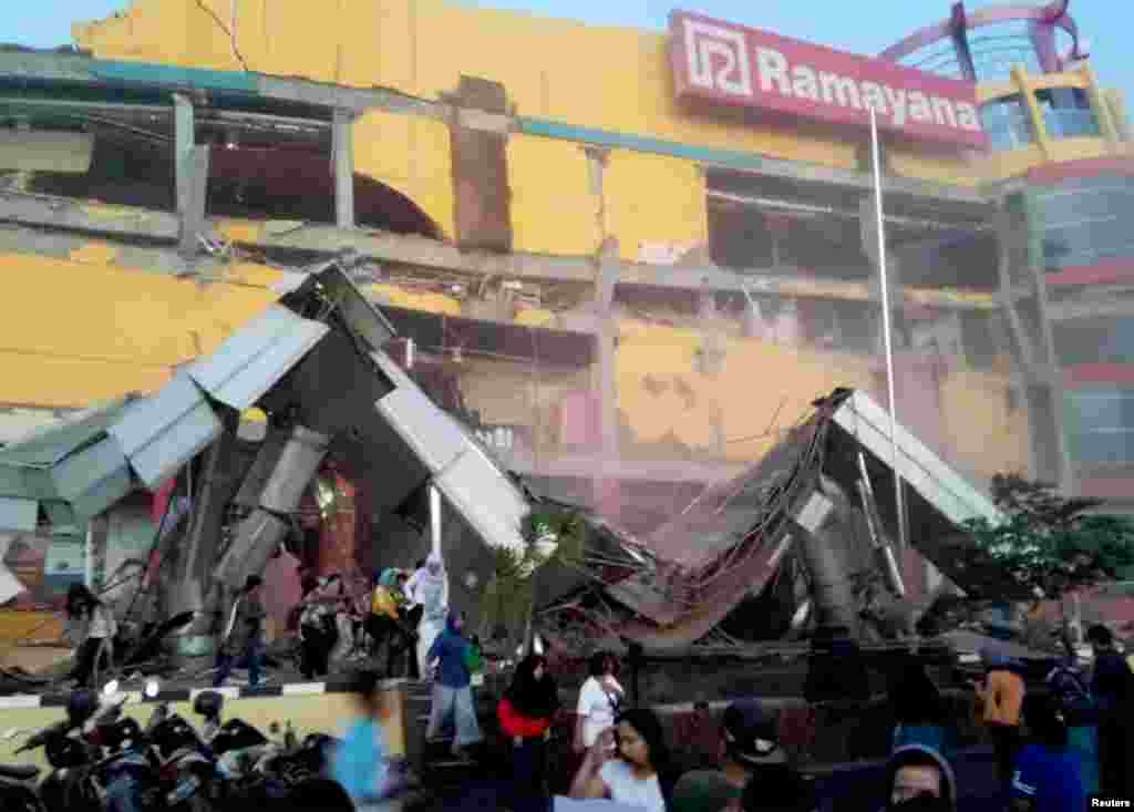 Heavy damage to a shopping center is seen following an earthquake in Palu, Central Sulawesi, Indonesia, Sept. 28, 2018, in this handout photo made available by Antara Foto.