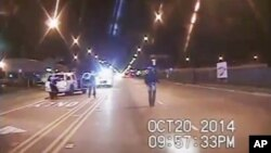 A frame grab from dash-cam video provided by the Chicago Police Department shows Laquan McDonald (R) walks down the street moments before being shot by officer Jason Van Dyke on Oct. 20, 2014.