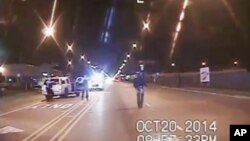 A frame grab from dash-cam video provided by the Chicago Police Department shows Laquan McDonald (R) walks down the street moments before being shot by officer Jason Van Dyke on Oct. 20, 2015.