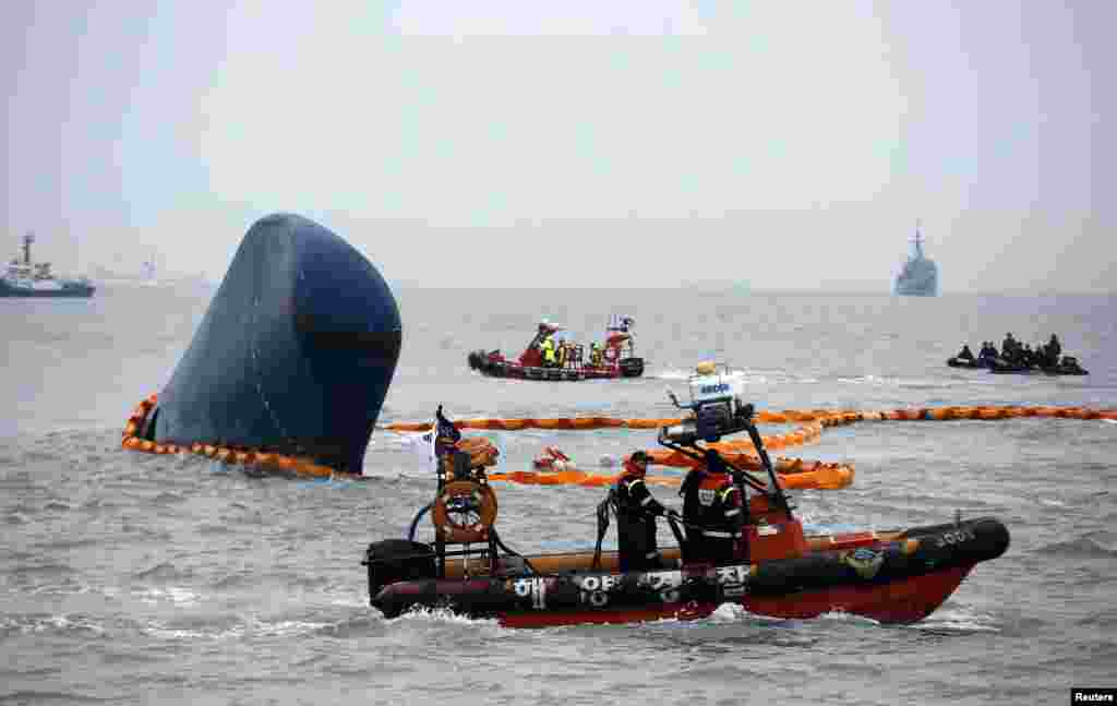 "Rescue boats sail around the South Korean ferry ""Sewol"" which sank, during the rescue operation in the sea off Jindo. South Korean coastguard and navy divers resumed searching on Thursday for people still missing, many of them students from the same high school, after a ferry capsized in sight of land."