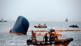 Rescue boats sail around the South Korean passenger ship