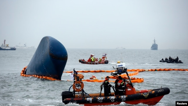 "Rescue boats sail around the South Korean passenger ship ""Sewol"" which sank, during their rescue operation in the sea off Jindo, April 17, 2014."