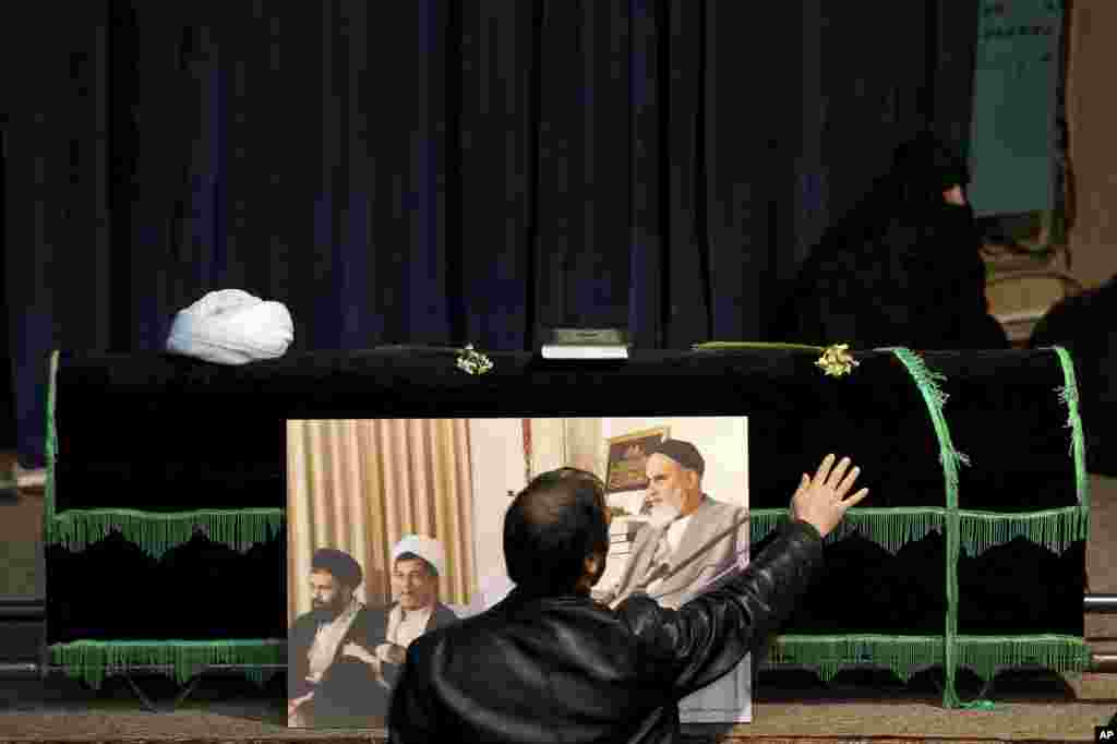 A man touches the coffin of former Iranian President Akbar Hashemi Rafsanjani, who died after suffering a heart attack, at the Jamaran mosque in north Tehran, Iran.