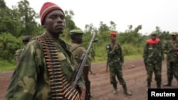 M23 rebel fighters occupy Rumangabo, after government troops abandoned the town, 23km north of the eastern Congolese city of Goma, July 28, 2012.