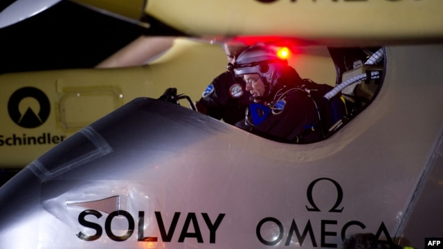 Bertrand Piccard, pilot of the Swiss sun-powered aircraft Solar Impulse prepares the craft for take off at the Barajas airport in Madrid, June 5, 2012.
