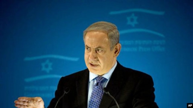 Israeli Prime Minister Benjamin Netanyahu delivers a statement to members of the foreign press in Jerusalem insisting that Iran will not stop its nuclear program unless economic sanctions are backed with a 'credible military option,' Jan. 11, 2011