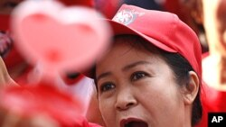 A woman takes part in the 'Red Shirt' anniversary protest at Ratchaprasong Intersection in Bangkok, Thailand, May 19, 2011.