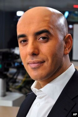 FILE - Notorious French gangster Redoine Faid poses for a photo prior to an interview with French TV channel, LCI, in Boulogne-Billancourt, outside Paris, France, Nov. 22, 2010.