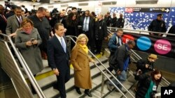 New York Gov. Andrew Cuomo (left) is surrounded by other guests and reporters as he tours the new 86th Street subway station in New York, Dec. 22, 2016. The first phase of the Second Avenue subway line, which has three stops, is scheduled to open Jan. 1, 2017.