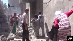 阿勒頗受到空襲下的居民